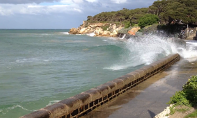 Sea wall hit by waves